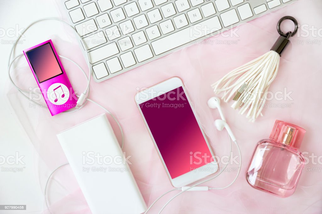 Flat lay With female tricks. Girls' pink party set. Glasses, smartphone, Pen, perfume, jewelry and accessories. stock photo