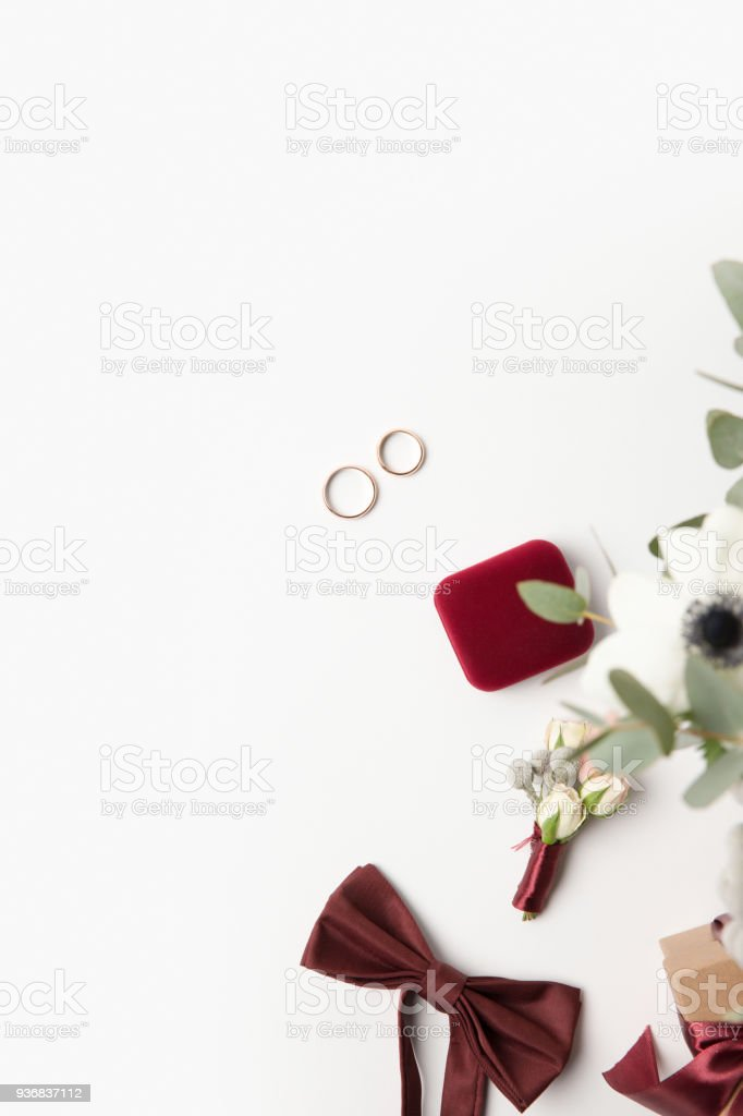 flat lay with gift, buttonhole, bow tie and jewelry box isolated on white stock photo