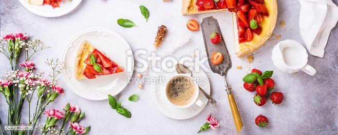 istock Flat lay with strawberry cheesecake 689925636