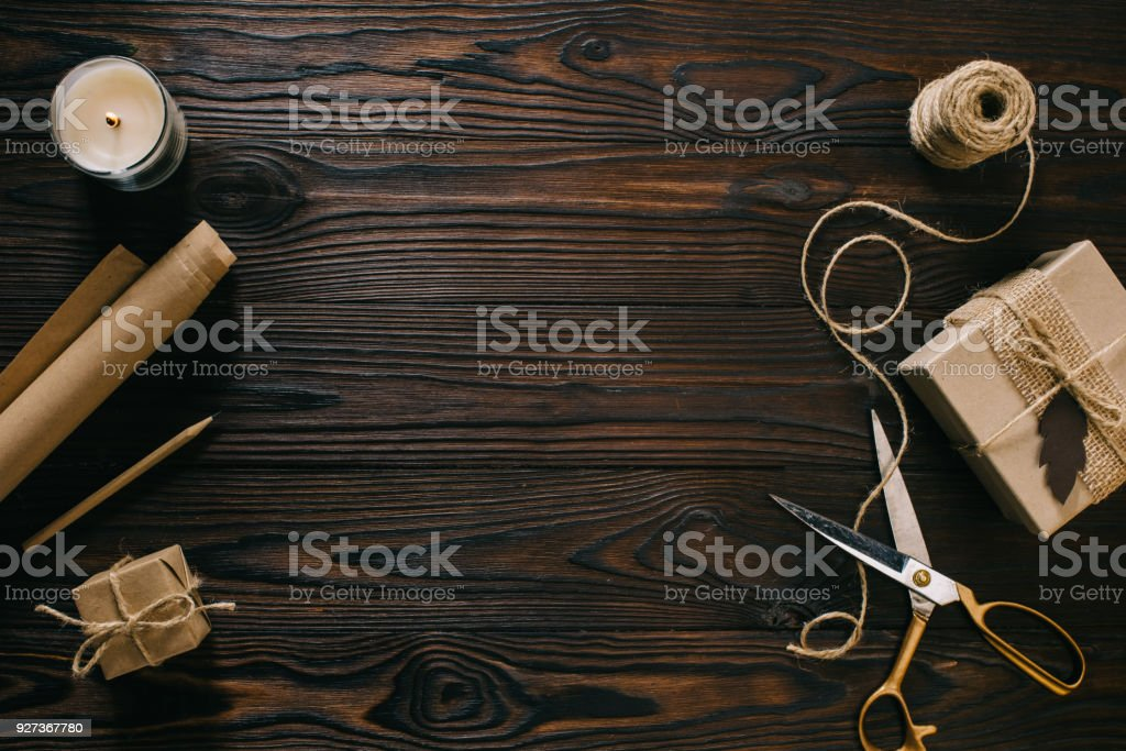 flat lay with wrapped presents, rope and scissors on wooden surface - Royalty-free Arrangement Stock Photo