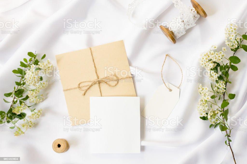 Flat lay workspace mockup wedding invitation cards craft wedding invitation cards craft envelopeswhite flowers stopboris Choice Image