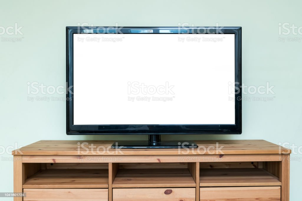 Flat LCD Television On Brown Wooden Cabinet In The Living Room With A White  Screen For