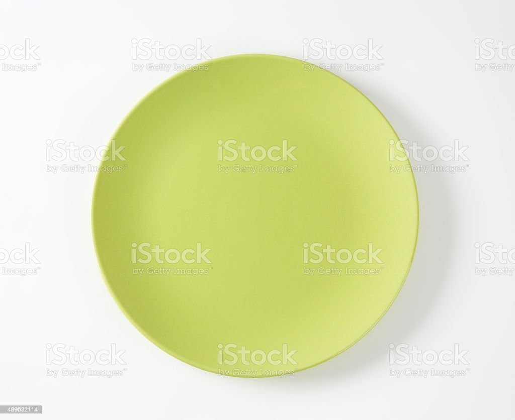Flat lime green dinner plate royalty-free stock photo & Flat Lime Green Dinner Plate stock photo | iStock