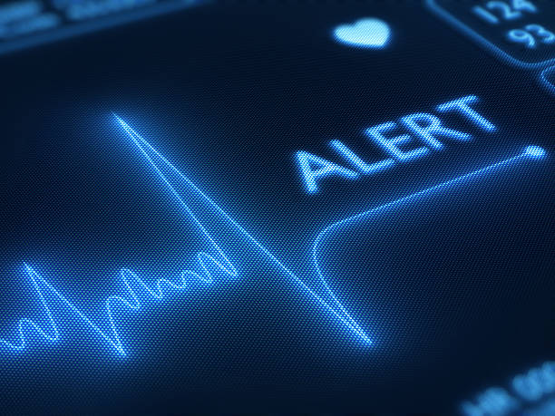 flat line alert on heart monitor - alertness stock photos and pictures