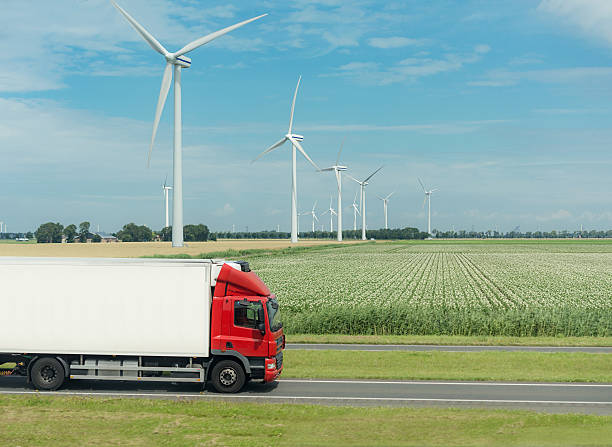 flat netherland  with truck, wind turbines and blooming crop stock photo