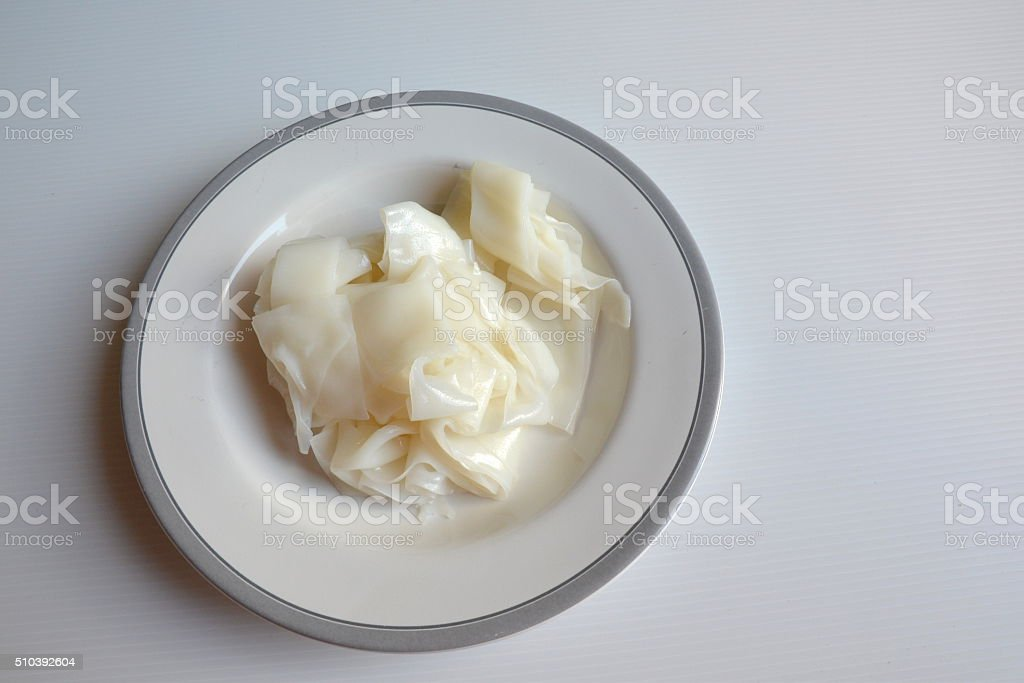 Flat noodle in dish stock photo