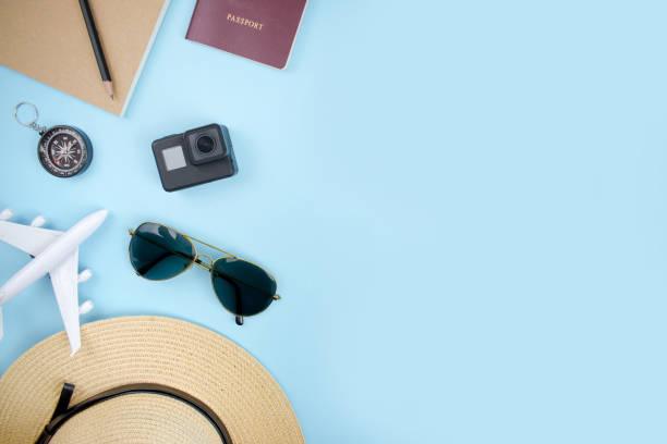 flat of summer items concept, traveler accessories notebook, pencil, camera, sunglasses, hat, plane and compass in top view. - phone, travelling, copy space imagens e fotografias de stock