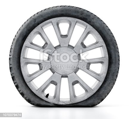 Flat, old tire and scratched wheel isolated on white.