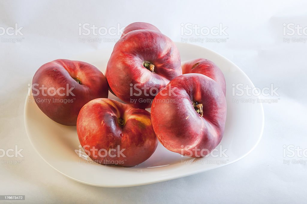 flat peach on white plate royalty-free stock photo