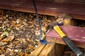 Flat pry bar and a claw hammer on a deck construction