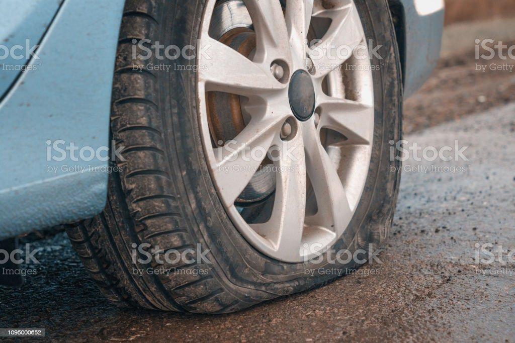 Flat rear tire on a car stock photo