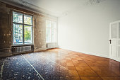 flat renovation, empty room before and after refurbishment or restoration photo merge -
