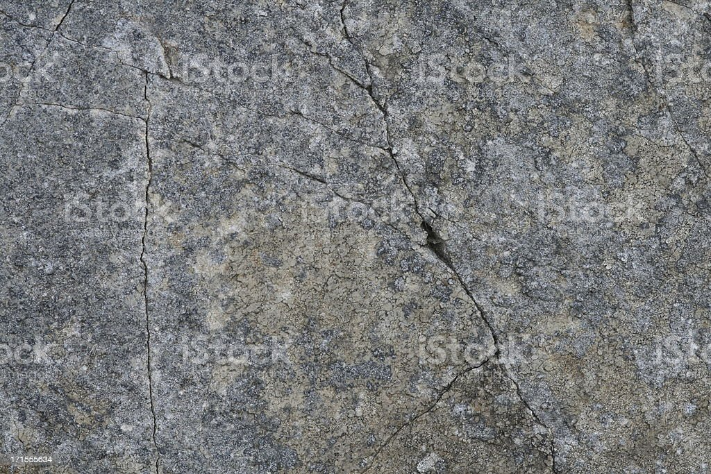 Flat rock surface with cracks royalty-free stock photo