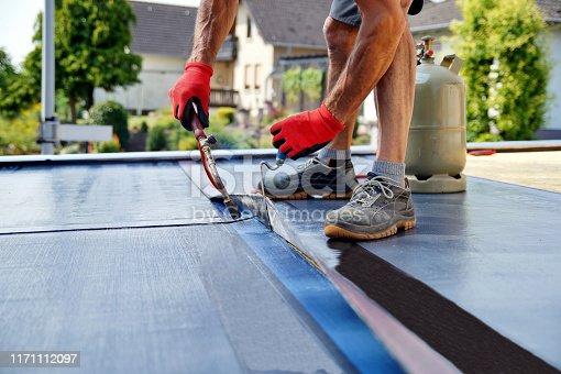 Roofing felt. Roofer working. Roofer working tool. Waterproofing