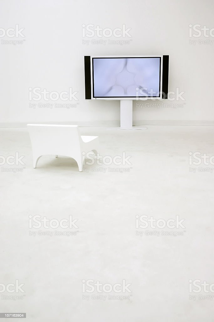 Flat screen in an empty and completely white room royalty-free stock photo