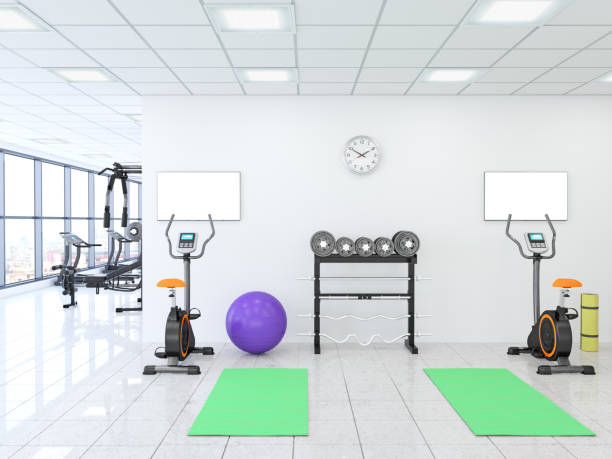 TV flat screen mock up on the wall in GYM - Fitness Center TV flat screen mock up on the wall in GYM - Fitness Center yoga studio stock pictures, royalty-free photos & images