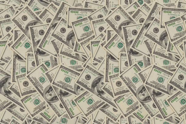 flat seamless texture and background of real one hundred us dollar banknotes stock photo