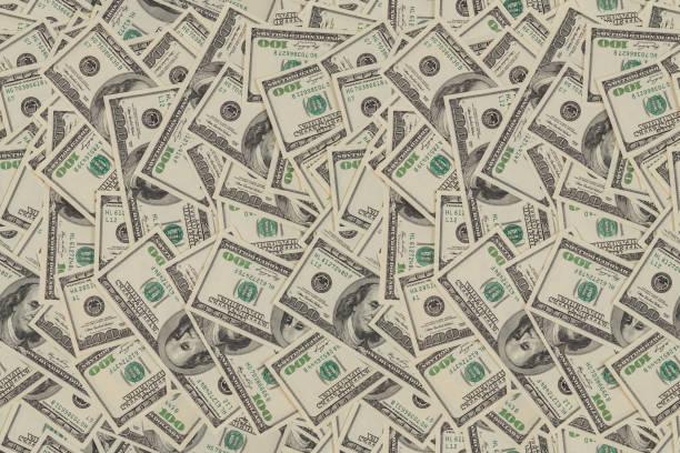 flat seamless texture and background of real one hundred us dollar banknotes - dinheiro imagens e fotografias de stock