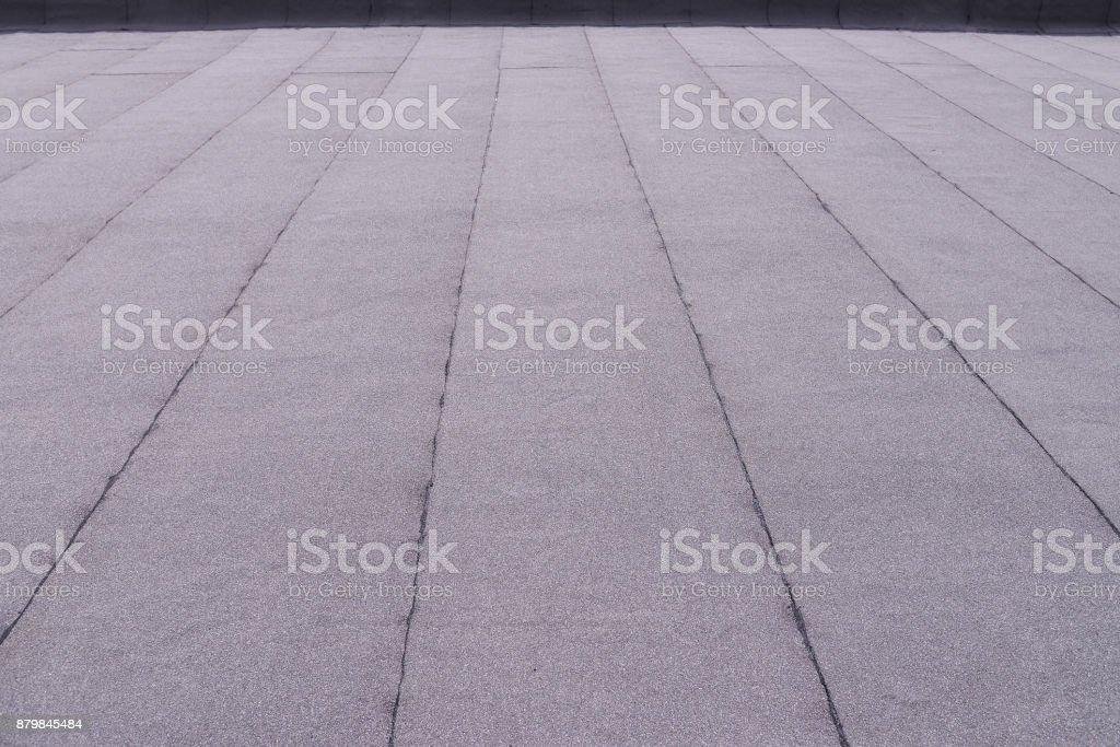 Recubrimiento de techo de superficie plana. Calentamiento y fusión de techos de betún fieltro patrón de fondo. - foto de stock