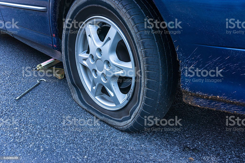 Flat tire on the road stock photo