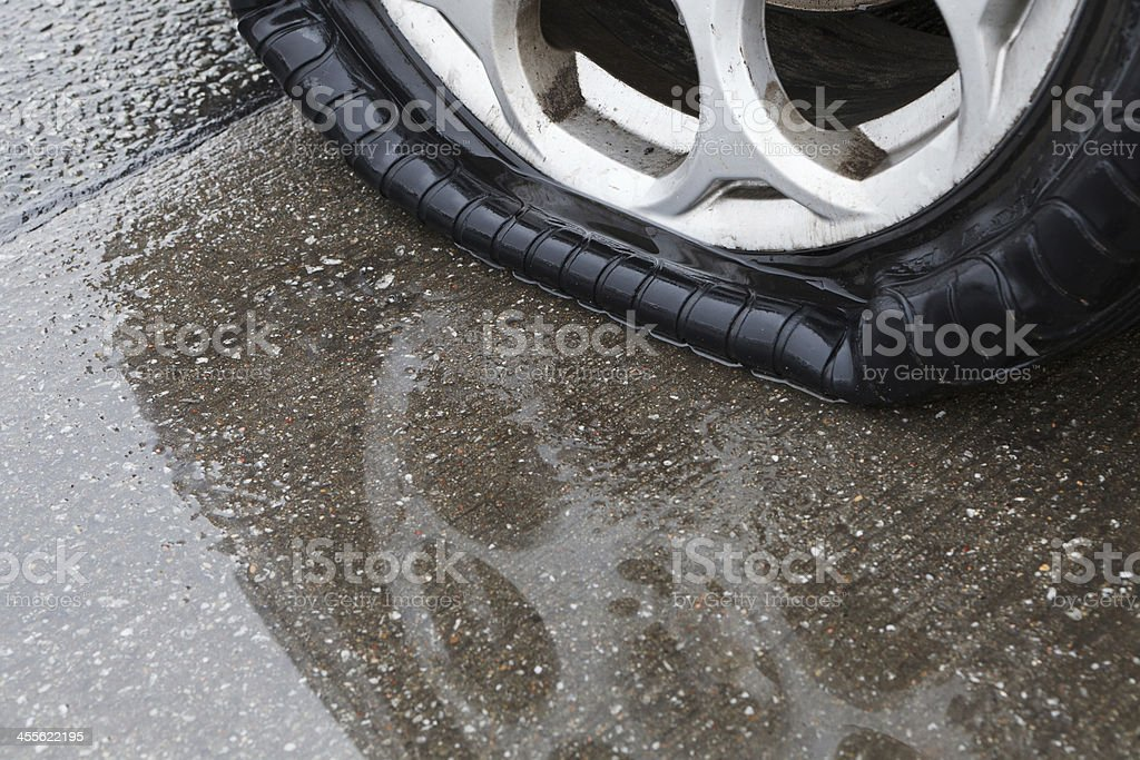 Flat tire royalty-free stock photo