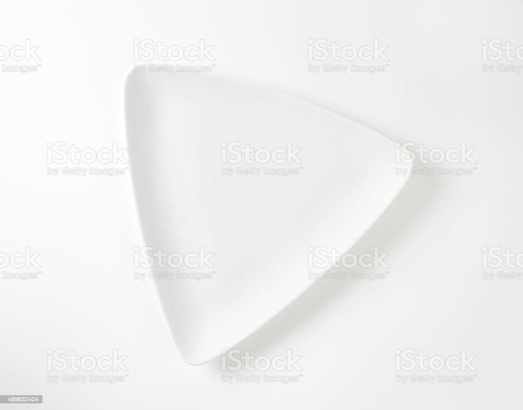 Flat triangle white plate stock photo