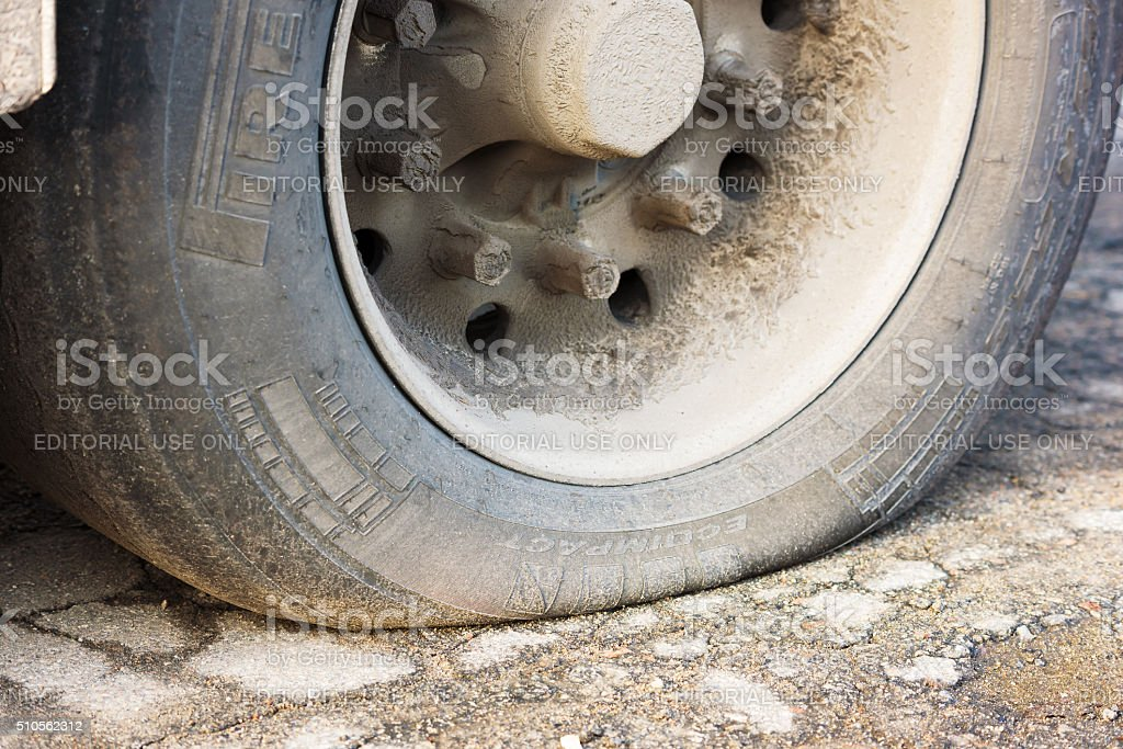 Flat truck tire stock photo