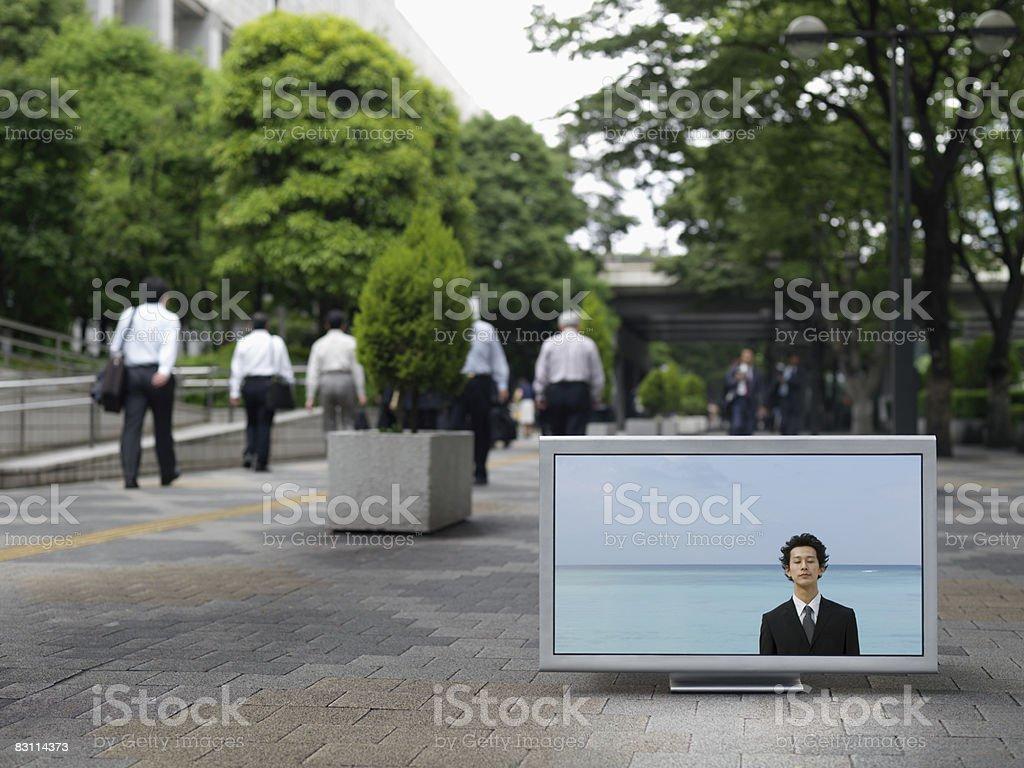 Flat TV placed on urban street royalty free stockfoto