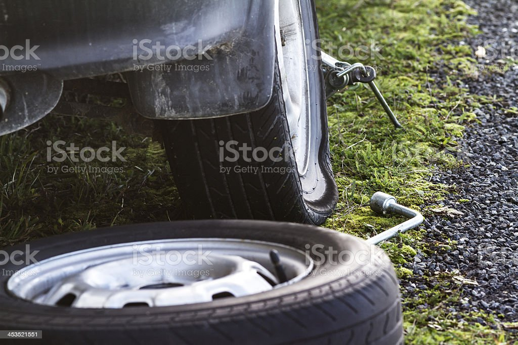 Flat tyre road side royalty-free stock photo