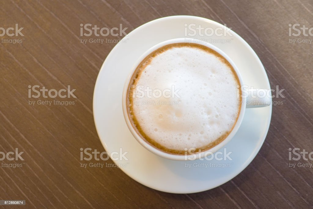 Flat view hot coffee in white cup on the wooden table lifestyle stock photo