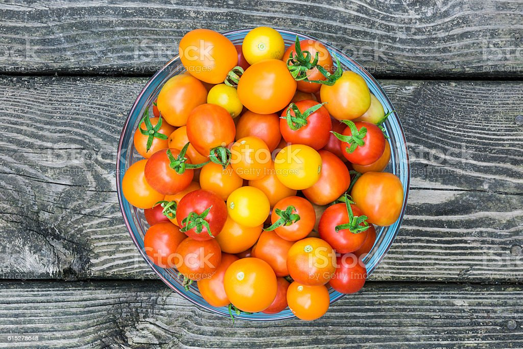 Flat view of red and yellow cherry tomatoes stock photo