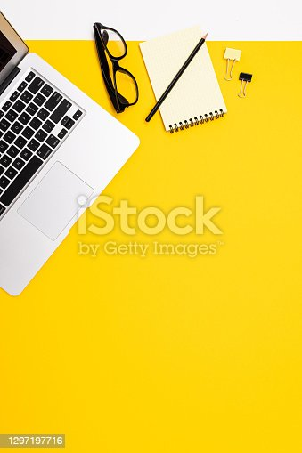 flat view of the office desk with a creative arrangement of stationery and notebooks for the desktop.