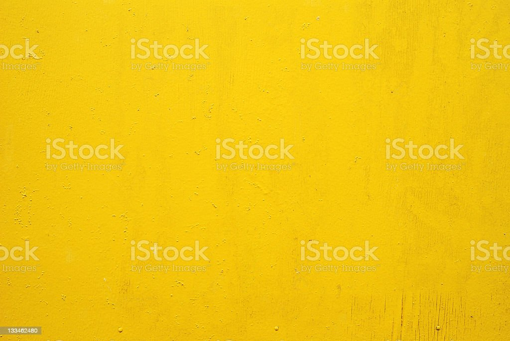 Flat yellow wall with small markings stock photo