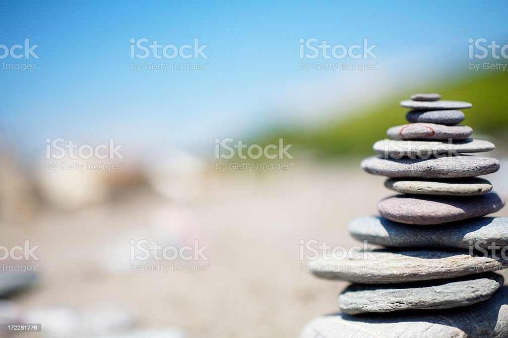 Flat Zen stones piled high at a beach royalty-free stock photo