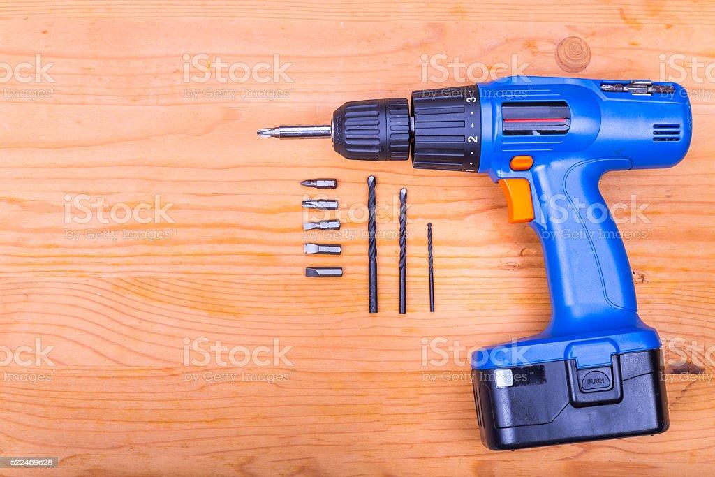 Flatbed of convenient cordless drill cum screwdriver set with bi stock photo