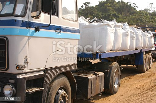 Chemical sacks being loaded on a truck to be shipped to drilling rigs.