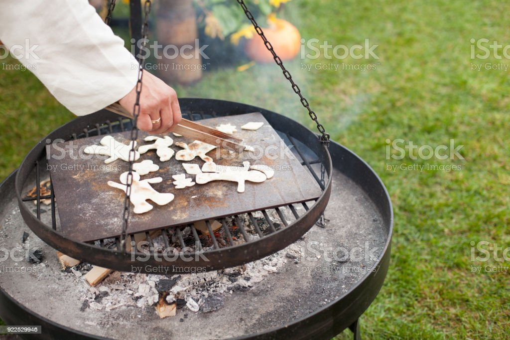 flatbread - a cake made of flour and water, baking over a fire stock photo