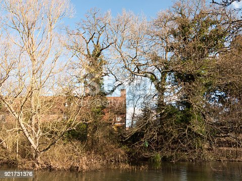 flatford mill house spring from across the lake on side river stour constable country close up; essex; england; uk