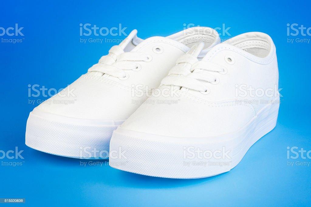 Flatform Plimsolls in white on blue