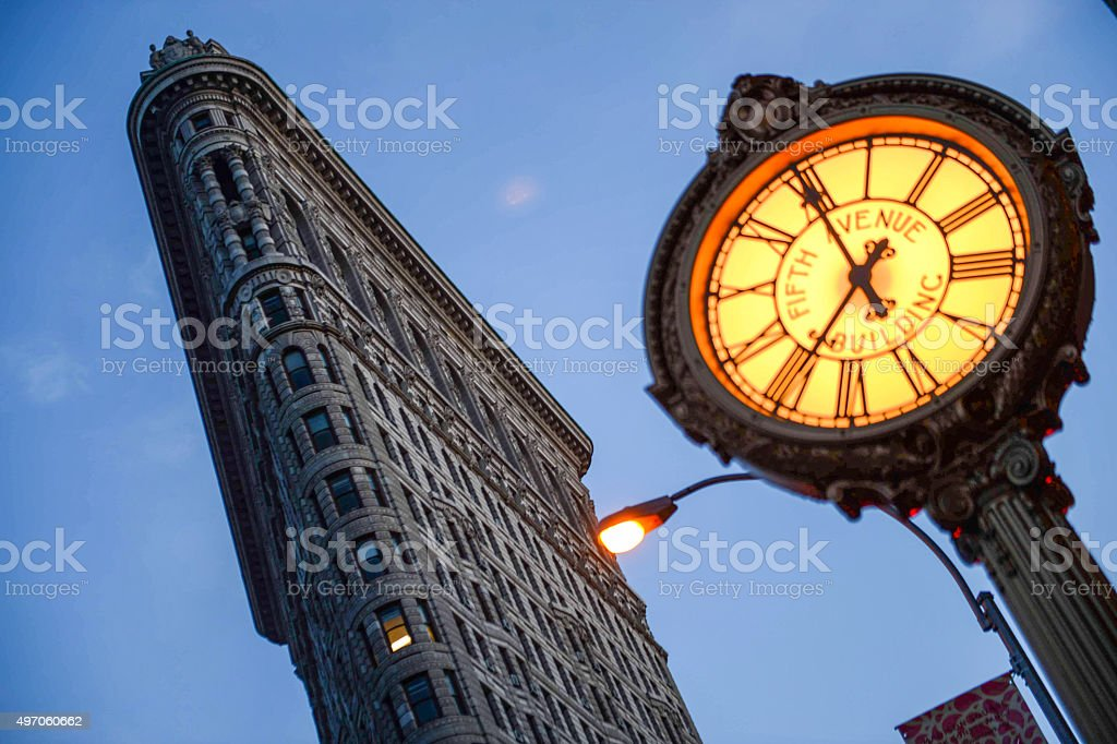 Flatiron building and fifth avenue clock - New York stock photo