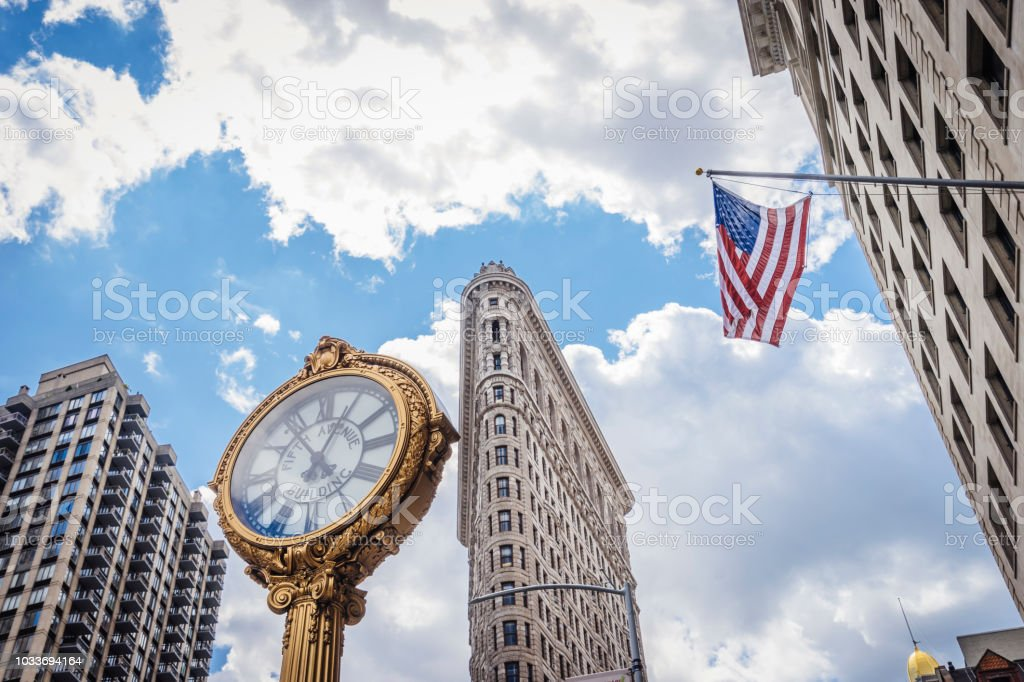 Flatiron building with golden clock in New York city stock photo