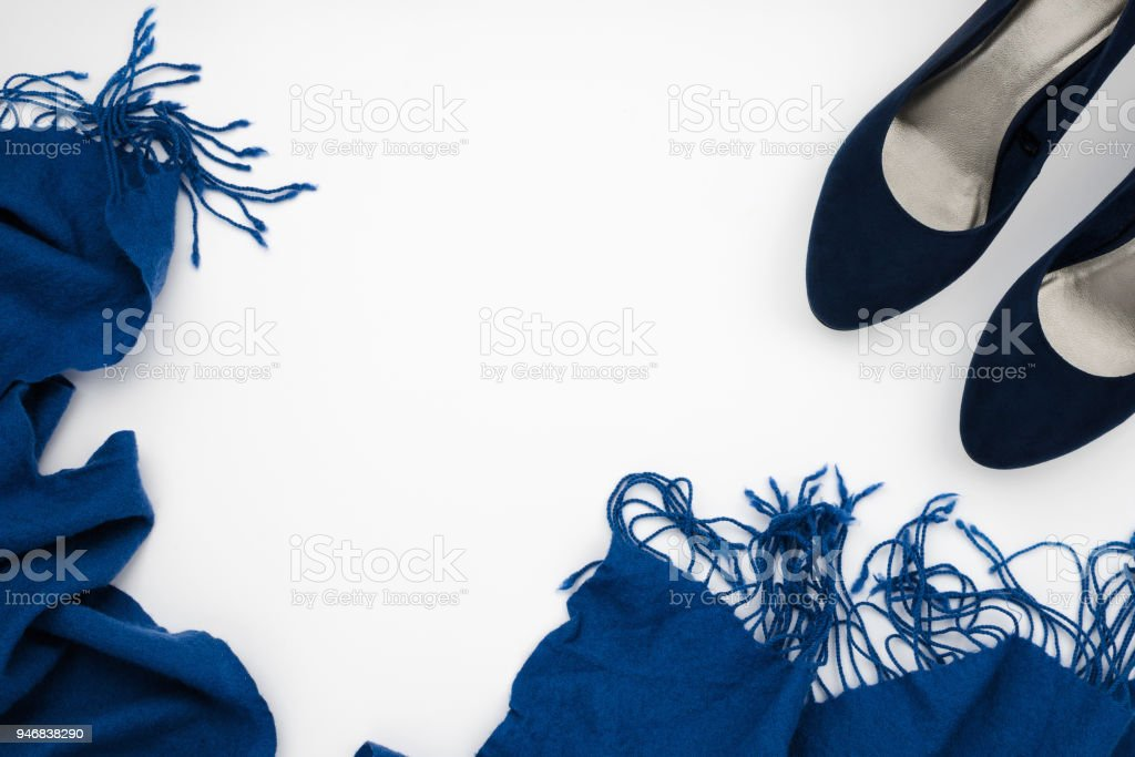 Flatlay frame arrangement with blue high heeled shoes and blue scarf, fashion concept, white background, copyspace stock photo