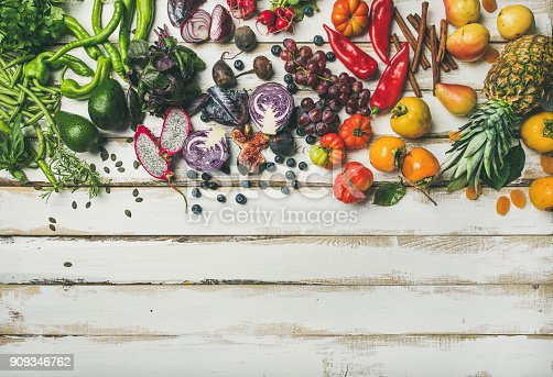 istock Flat-lay of fresh fruit, vegetables, greens and superfoods, copy space 909346762