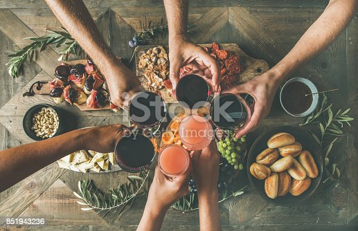 istock Flat-lay of friends eating and drinking together, top view 851943236
