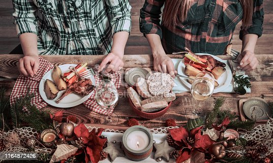 istock Flat-lay of friends hands eating and drinking together. Top view of people having party. 1164872426