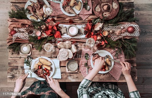 istock Flat-lay of friends hands eating and drinking together. Top view of people having party, gathering, celebrating together at wooden rustic table 1171784035