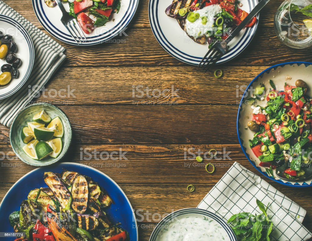 Flat-lay of healthy dinner table setting with vegetarian snacks royalty-free stock photo