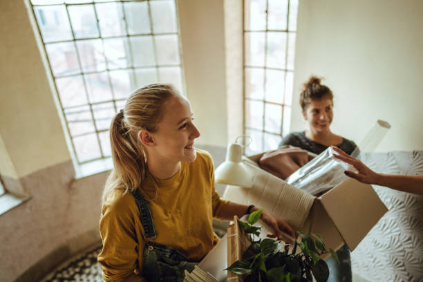 Flatmates are moving into a students dorm stock photo