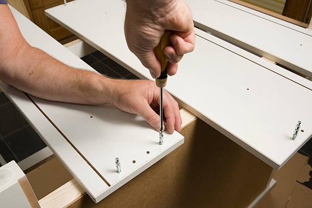 Flat-pack furniture assembly stock photo