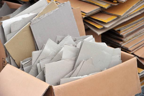 flattened cardboard boxes being recycled - puste pudełko zdjęcia i obrazy z banku zdjęć